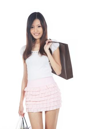 compras compulsivas: Asia compras con bolsas aisladas sobre fondo blanco