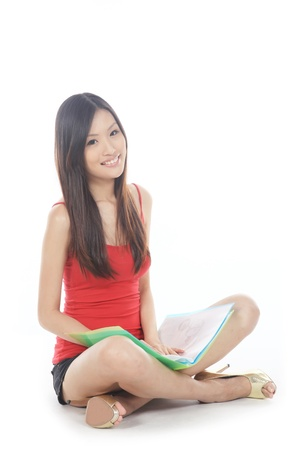 Asian College Sitting On The Floor Isolated photo
