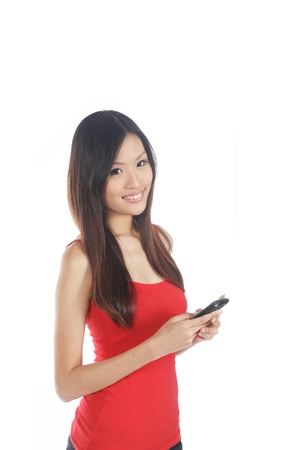 Asian Girl Using Mobile Phone on White Background photo