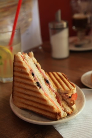 Grilled Ham and Cheese Sandwich Mean With Drink Imagens