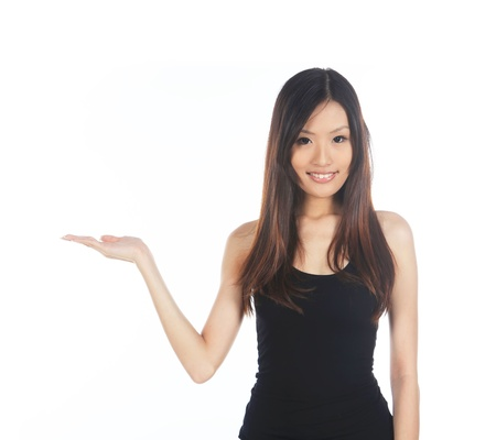 Asian Woman Holding Out For Hand Product Placement photo