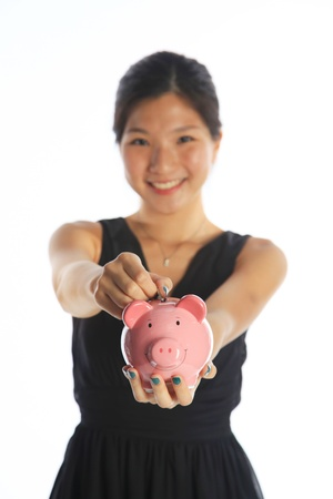 college fund savings: Savings and Investment Concept with an Asian Lady