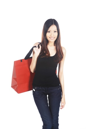 Happy Asian Woman Holding Shopping Bag With Hand photo
