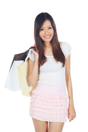 Happy Asian Shopper Holding Shopping Bag With Hand photo