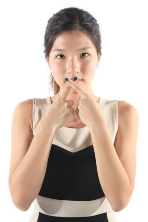 crossing fingers: Female Covering Mouth while Crossing Fingers Concept Stock Photo
