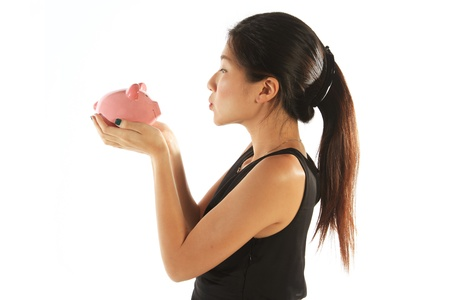 Asian Woman Kissing Piggy Bank Business Concept photo