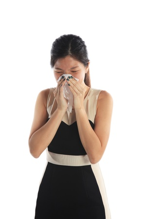 Sick Asian Woman with Tissue Paper Sneezing photo