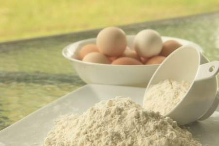Baking Flour in Outdoor Setting with Eggs photo