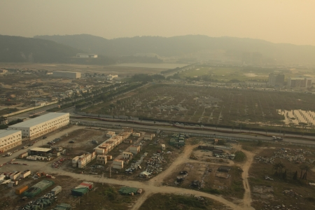 undeveloped: Industrial Wasteland in China with Pollution Smog