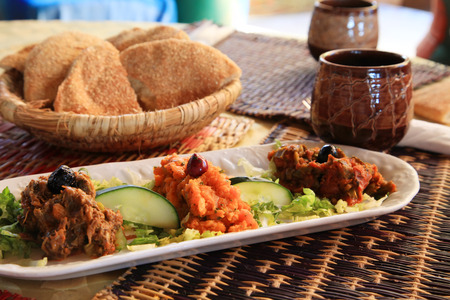 moroccan cuisine: Moroccan Salad and Bread in a Basket in Morocco