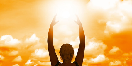 final thoughts: Woman Holding the Sun as a Motivational Concept Abstract Stock Photo