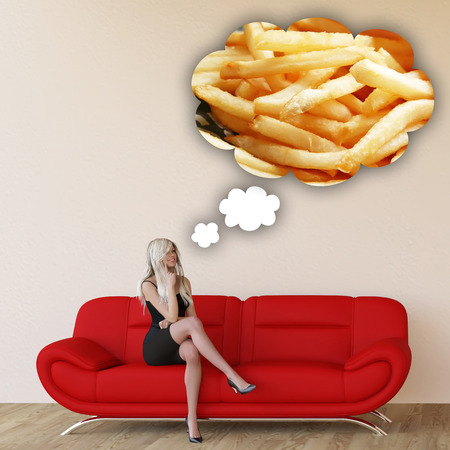 craving: Woman Craving French Fries and Thinking About Eating Food