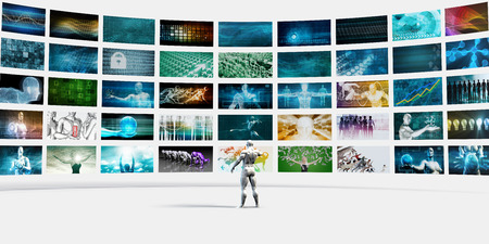 video wall: Man Pointing at a Video Wall Filled with Screens Stock Photo