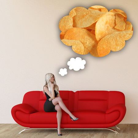 craving: Woman Craving Potato Chips and Thinking About Eating Food