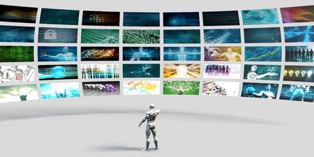Man wijst naar een videomuur gevuld met schermen Stockfoto