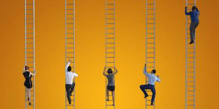 Business People Climbing Ladders to Reach the Top Imagens