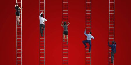 Business People Climbing Ladders to Reach the Top 写真素材
