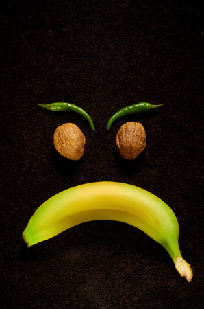 the emotion of anger using organic products of banana, nuts and pepper