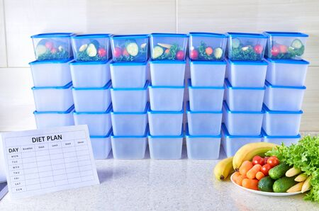 A meal plan for a week on a white table among set of plastic containers for food and food. Proper nutrition five times a week
