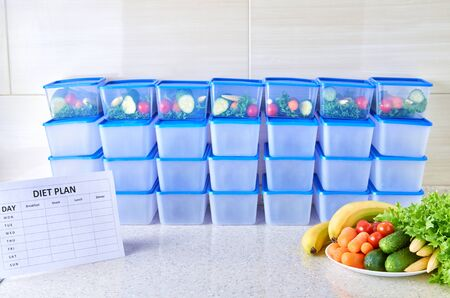 A meal plan for a week on a white table among set of plastic containers for food and food. Proper nutrition four times a week.