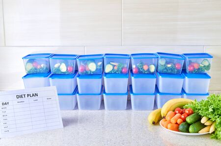 A meal plan for a week on a white table among set of plastic containers for food and food. Proper nutrition three times a week.