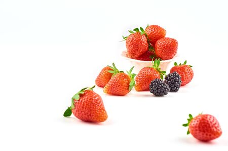 Composition of strawberries, blackberries, blueberries, raspberries and red currants on a white background.