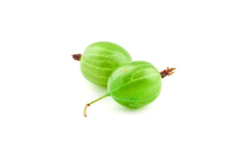Two green gooseberry berry isolated on white background. Stock Photo