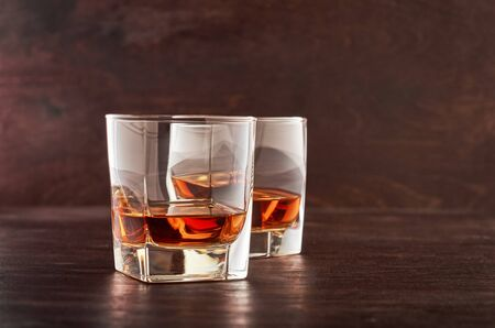 Two glasses of whiskey on a wooden table Stok Fotoğraf