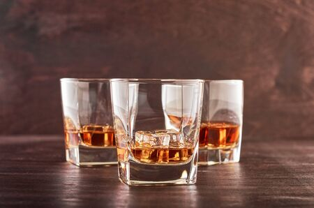 Three glasses of whiskey on a wooden table Stok Fotoğraf