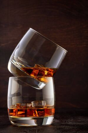 Two glasses of whisky and ice on the wooden table. Stok Fotoğraf