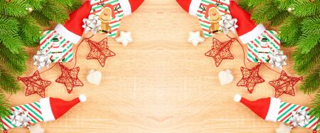 Christmas background with fir branches, various Christmas decorations, colored garlands and beads, on a light wood background. Christmas decorations. Christmas background. Space for text. Archivio Fotografico - 134424809