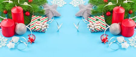 Christmas background with fir branches, various christmas decorations, colored garlands and beads, on a blue background. Christmas decoration. Christmas background. Space for text. Archivio Fotografico - 134424813