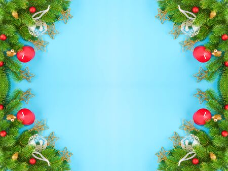 Christmas background with fir branches, various christmas decorations, colored garlands and beads, on a blue background. Christmas decoration. Christmas background. Space for text. Archivio Fotografico - 134424816