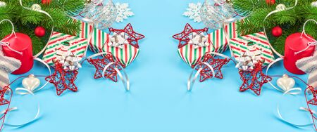 Christmas background with fir branches, various christmas decorations, colored garlands and beads, on a blue background. Christmas decoration. Christmas background. Space for text. Archivio Fotografico - 134285534