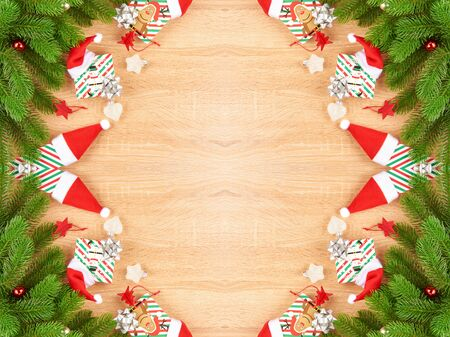 Christmas background with fir branches, various Christmas decorations, color garlands and beads, on a light wood background. Archivio Fotografico - 134070479