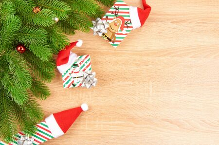 Christmas background with fir branches, various Christmas decorations, colored garlands and beads, on a light wood background. Christmas decorations. Christmas background. Space for text. Archivio Fotografico - 133807675