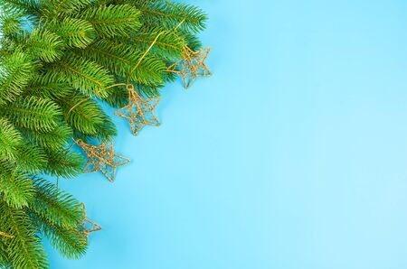 Christmas background with fir branches, various christmas decorations, colored garlands and beads, on a blue background. Christmas decoration. Christmas background. Space for text. Archivio Fotografico - 133807677