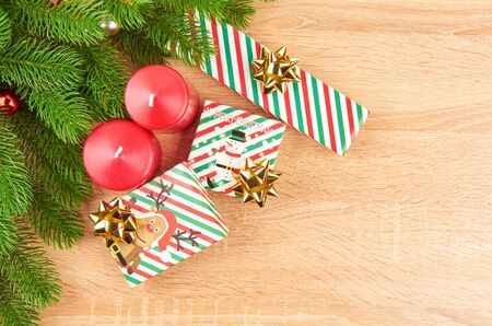 Christmas background with fir branches, various Christmas decorations, colored garlands and beads, on a light wood background. Christmas decorations. Christmas background. Space for text. Archivio Fotografico - 133936364
