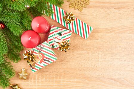 Christmas background with fir branches, various Christmas decorations, colored garlands and beads, on a light wood background. Christmas decorations. Christmas background. Space for text. Archivio Fotografico - 133936377