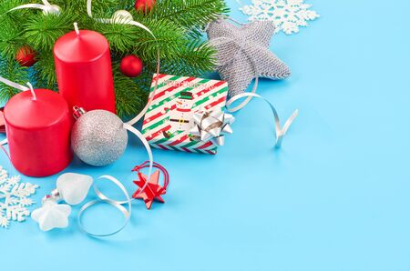 Christmas background with fir branches, various christmas decorations, colored garlands and beads, on a blue background. Christmas decoration. Christmas background. Space for text. Archivio Fotografico - 133936449