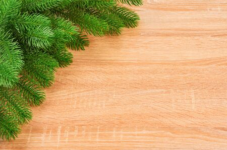Christmas background with fir branches, various Christmas decorations, colored garlands and beads, on a light wood background. Christmas decorations. Christmas background. Space for text. Archivio Fotografico - 133936451