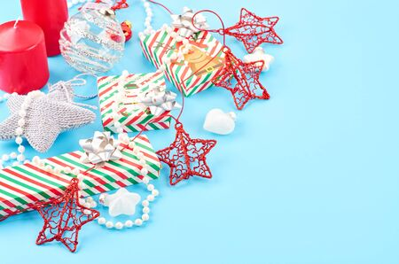 Christmas background with various Christmas decorations, colored garlands and beads, on a blue background. Christmas decorations. Christmas background. Space for text. Archivio Fotografico - 133936466