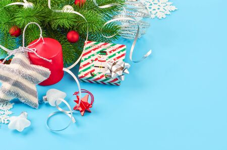 Christmas background with fir branches, various christmas decorations, colored garlands and beads, on a blue background. Christmas decoration. Christmas background. Space for text. Archivio Fotografico - 134279919