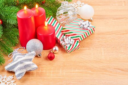 Christmas background with fir branches, various Christmas decorations, colored garlands and beads, on a light wood background. Christmas decorations. Christmas background. Space for text. Archivio Fotografico - 133937375