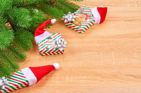 Christmas background with fir branches, various Christmas decorations, colored garlands and beads, on a light wood background. Christmas decorations. Christmas background. Space for text. Archivio Fotografico - 133937376