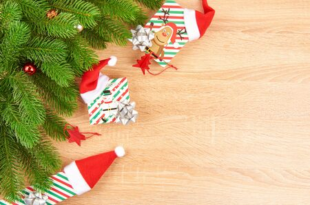 Christmas background with fir branches, various Christmas decorations, colored garlands and beads, on a light wood background. Christmas decorations. Christmas background. Space for text. Archivio Fotografico - 133937379