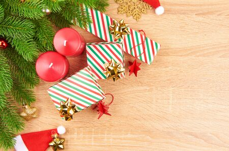 Christmas background with fir branches, various Christmas decorations, colored garlands and beads, on a light wood background. Christmas decorations. Christmas background. Space for text. Archivio Fotografico - 133884905