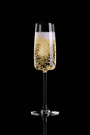 A glass of champagne isolated on a black background. Archivio Fotografico - 134237488