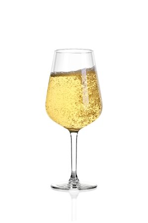Glass of white wine isolated on white background. The wine boils in the glass. Archivio Fotografico - 135584356