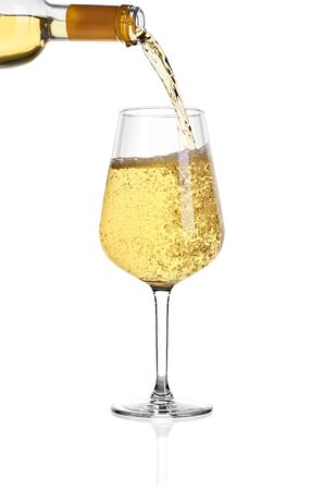 Glass of white wine isolated on white background. From above in glass is poured wine from the bottle. Archivio Fotografico - 135584057